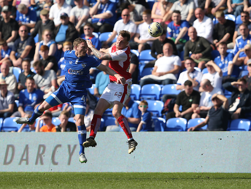 Fleetwood Town's Martyn Woolford battles with Oldham Athletic's Brian Wilson<br /> <br /> Photographer Stephen White/CameraSport<br /> <br /> The EFL Sky Bet League One - Oldham Athletic v Fleetwood Town - Saturday 8th April 2017 - SportsDirect.com Park - Oldham<br /> <br /> World Copyright &copy; 2017 CameraSport. All rights reserved. 43 Linden Ave. Countesthorpe. Leicester. England. LE8 5PG - Tel: +44 (0) 116 277 4147 - admin@camerasport.com - www.camerasport.com
