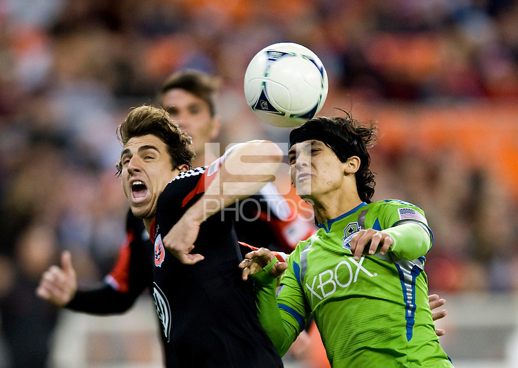 Dejan Jakovic (5) of D.C. United fights for the ball with Fredy Montero (17) of the Seattle Sounders at RFK Stadium in Washington DC.   D.C. United tied  the Seattle Sounders, 0-0.