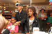 West Tisbury, MA - August 30, 2009 -- United States President Barack Obama and daughters Malia, (R), and Sasha buy some snacks at Alley's General Store August 30, 2009 in West Tisbury, Massachusetts. The president is spending his last day on Martha's Vineyard before returning to Washington later today..Credit: Darren McCollester / Pool via CNP
