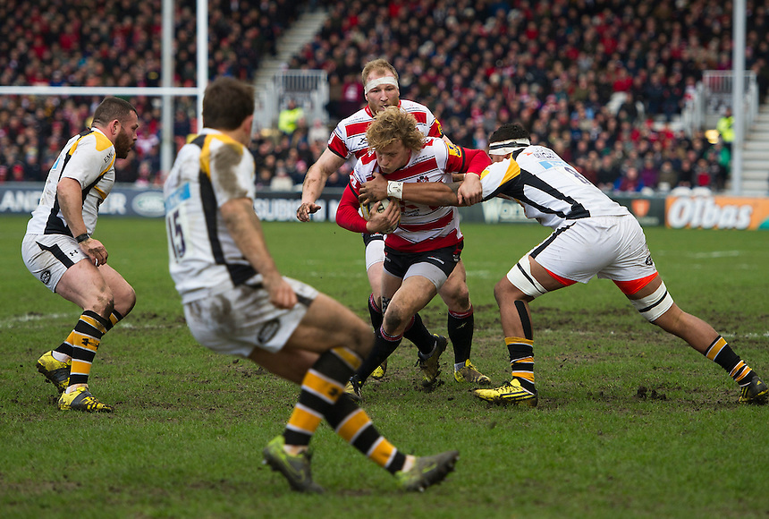 Gloucester Rugby's Billy Twelvetrees is tackled by Wasps' Nathan Hughes<br /> <br /> Photographer Ashley Western/CameraSport<br /> <br /> Rugby Union - Aviva Premiership Round 15 - Gloucester Rugby v Wasps - Saturday 5th March 2016 - Kingsholm Stadium - Gloucester<br /> <br /> &copy; CameraSport - 43 Linden Ave. Countesthorpe. Leicester. England. LE8 5PG - Tel: +44 (0) 116 277 4147 - admin@camerasport.com - www.camerasport.com