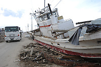 A boat lies in the road 2 km from the coastline in the town of  Natori, after the Tsunami devastated the entire pacifc coastline of Japan after the earthquake and tsunami devastated the area Sendai, Japan.<br /><br />photo by Richard Jones/ sinopix