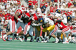 University of Wisconsin defense swarms West Virginia University (22) Avon cobourne during the game at Camp Randall Stadium in Madison, WI, on 9/7/02. The Badgers beat West Virginia 34-17.  (Photo by David Stluka)