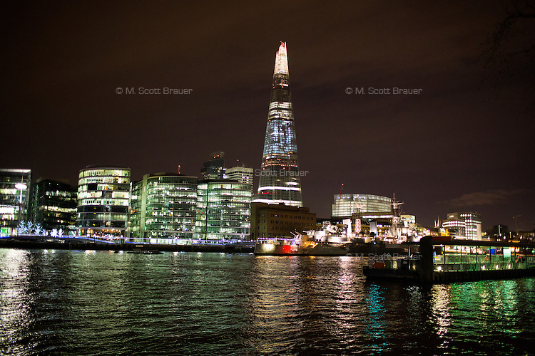 The Shard stands above other buildings on the waterfront on the River Thames in London, England.
