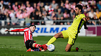 Lincoln City's Tom Pett vies for possession with Cheltenham Town's Conor Thomas<br /> <br /> Photographer Chris Vaughan/CameraSport<br /> <br /> The EFL Sky Bet League Two - Lincoln City v Cheltenham Town - Saturday 13th April 2019 - Sincil Bank - Lincoln<br /> <br /> World Copyright &copy; 2019 CameraSport. All rights reserved. 43 Linden Ave. Countesthorpe. Leicester. England. LE8 5PG - Tel: +44 (0) 116 277 4147 - admin@camerasport.com - www.camerasport.com