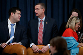United States Representative Doug Collins (Republican of Georgia), Ranking Member, US House Judiciary Committee (C) talks with a staff member following the House Judiciary Committee's markup of House Resolution 755, Articles of Impeachment Against President Donald J. Trump on Capitol Hill in Washington, DC, USA, 11 December 2019. The House Judiciary Committee has written 2 articles of impeachment accusing US President Donald J. Trump of abuse of power and obstruction of Congress.<br /> Credit: Shawn Thew / Pool via CNP