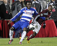 Ugo Ihemelu#3 of FC Dallas clashes with Omar Cummings#14 of the Colorado Rapids during MLS Cup 2010 at BMO Stadium in Toronto, Ontario on November 21 2010.Colorado won 2-1 in overtime.