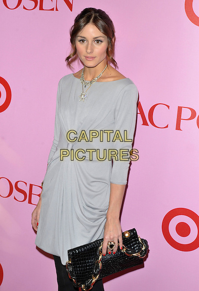 OLIVIA PALERMO .Zac Posen For Target Collection Launch held at the New Yorker Hotel, New York, NY, USA, 15th April 2010..half length grey gray ruched dress sleeves slash boat neck silver necklace hair up bag clutch gold knotted black ring .CAP/ADM/BM.©Bill Menzel/AdMedia/Capital Pictures.