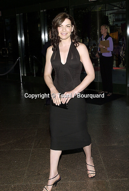 Julianna Marguiles arriving at the premiere of Mist of Avalon at the Director Guild of America in Los Angeles. The Mist of Avalon is the legendary story of Camelot seen through the eyes of the women who wielded power behind King Arthur throne. June 25, 2001  © TsuniMarguliesJulianna06.JPG