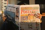 Istanbul, Turkey, Aboard Bosphorus ferry, Man reading newspaper, morning commute, sunrise,