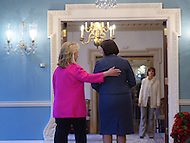 December 14, 2011  (Washington, DC)  After signing a cultural heritage preservation agreement at the Department of State, U.S. Secretary of State Hillary Clinton (left) and the President of Kosovo, Atifete Jahjaga (right), leave the Treaty Room.    (Photo by Don Baxter/Media Images International)