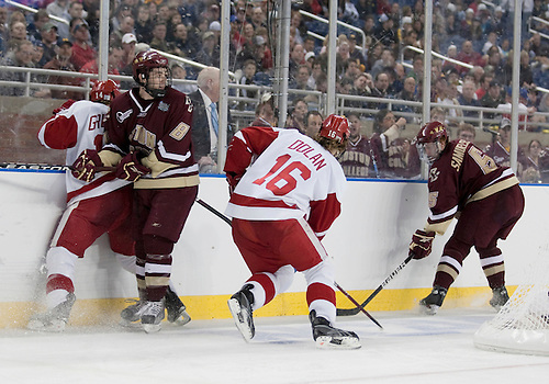 10 April 2010: Boston College Defenseman Philip Samuelsson (#5) and Wisconsin Forward Sean Dolan (#16) battle for puck while Boston College Defenseman Edwin Shea (#8) checks Wisconsin Forward Ben Grotting (#14) in game action between the Wisconsin Badgers and the Boston College Eagles at Ford Field in Detroit, Michigan.  Boston College defeated Wisconsin 5-0. Mandatory Credit: John Mersits / Southcreek Global