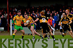 Johnny Buckley of Dr Crokes tries to hold off Gneeveguilla's Donie O'Connor in Gneeveguilla last Sunday evening in round 1 of the Garvey's Supervalue County Senior Championship.