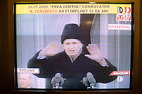 ROMANIA / Bucharest / 26.01.2009..A television screen shot of Romanian Communist dictator Nicolae Ceausescu's last speech on 21 December 1989 moments before the 100,000 person strong crowd began to riot against the regime . Romanian television played a documentary about his rule of Romania on the occasion of his birthday, 26 January. Ceausescu would have been 91 years-old in 2009, but he and his wife were executed by firing squad on Christmas day 1989 during the Romanian revolution. Romania experienced the most oppressive of the former Eastern Bloc's Communist regimes and by the late 1980s shops were empty of food, the imfamous secret police called the Securitate had created a police state and Ceausescu had launched grandisose Communist building projects modeled after North Korea that involved leveling one fifth of historic Bucharest...© Davin Ellicson / Anzenberger