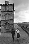 Saltaire, Bradford. 1981<br /> 1 Albert Terrace, a model village built by the mill owner Sir Titus Salt. He died in 1876, it is estimated that as many 100,000 people lined the street to watch the funeral cortege. Young women factory workers walking back to work after their lunch hour.