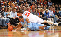 Jan. 8, 2011; Charlottesville, VA, USA;  North Carolina Tar Heels guard Leslie McDonald (2) fights for the loose ball with Virginia Cavaliers forward Will Sherrill (22) during the game at the John Paul Jones Arena. Mandatory Credit: Andrew Shurtleff