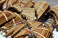 Andean bamboo panpipes or rondadores and other traditional musical instruments for sale at the Handicrafts market in Poncho Plaza, Otavalo, Ecuador