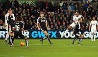 Andre Ayew of Swansea (R in white) takes a shot at goal during the Barclays Premier League match between Swansea City and Watford at the Liberty Stadium, Swansea on January 18 2016