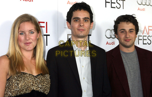 "JASMINE McGLADE, DAMIEN CHAZELLE & JUSTIN HURWITZ.AFI Fest 2009 ""The Hole in 3D"" presented by Audi at The Chinese Mann 6 Theaters, Hollywood, California, USA, 31st October 2009..half length black maroon burgundy jacket leopard print animal director producer composer .CAP/ADM/MJ.©Michael Jade/Admedia/Capital Pictures"