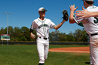 Dartmouth Big Green left fielder Dustin Shirley (6) high fives teammates in between innings during a game against the Villanova Wildcats on March 3, 2018 at North Charlotte Regional Park in Port Charlotte, Florida.  Dartmouth defeated Villanova 12-7.  (Mike Janes/Four Seam Images)