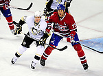 6 February 2010: Pittsburgh Penguins' center Sidney Crosby looks for a centering pass while Montreal Canadiens defenseman Hal Gill (75) keeps close during the first period at the Bell Centre in Montreal, Quebec, Canada. The Canadiens defeated the Penguins 5-3. Mandatory Credit: Ed Wolfstein Photo