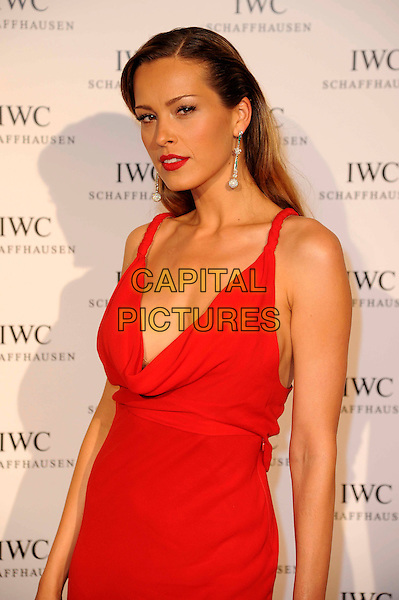Petra Nemcova.IWC Filmmakers Dinner at Hotel Du Cap-Eden-Roc, 65th Cannes Film Festival, Cannes, France..May 21st, 2012.half length red dress cowl neck low cut neckline dangling earrings.CAP/CAS.©Bob Cass/Capital Pictures.