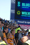 Wolves fans watching the second half action at St. Andrew's stadium, during Birmingham City's Barclay's Premier League match with Wolverhampton Wanderers. Both clubs were battling against relegation from  England's top division. The match ended in a 1-1 draw, watched by a crowd of 26,027.
