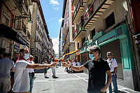 PAMPLONA, SPAIN - July 06: Two men make a toast in the famous Estafeta Street on the day when the ''txupinazo'' would usually take place to start the famous San Fermin festival, which was canceled this year by the conoravirus. In Pamplona, July 06, 2020(Photo by Maite H. Mateo /VIEWpress via Getty Images)