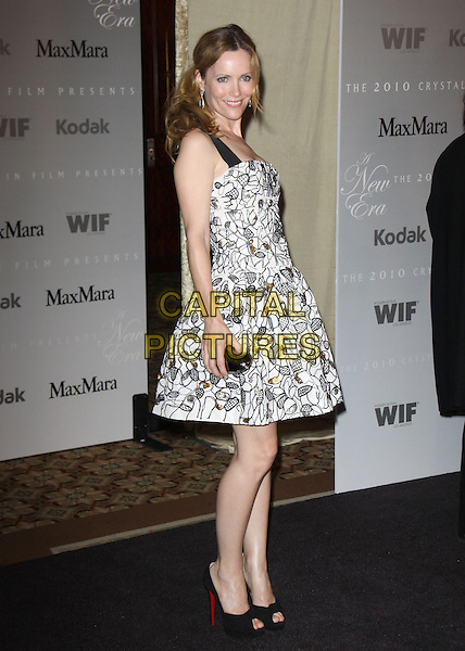 LESLIE MANN.The 2010 Women in Film Crystal + Lucy Awards held at The  Hyatt Regency Century Plaza in Century City, California, USA..June 1st, 2010        .full length black white pattern dress peep toe shoes clutch bag side  .CAP/RKE/DVS.©DVS/RockinExposures/Capital Pictures.