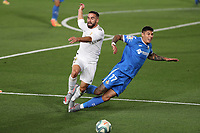 2nd July 2020, Madrid, Spain;  Real Madrids Dani Carvajal collides with Getafe s Mathias Olivera during the Spanish league football match between Real Madrid and Getafe in Madrid, Spain