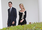 Presidential Advisors Jared Kushner and Ivanka Trump walk the Colonnade at The White House while attending  a state visit by French President Emmanuel Macron to Washington, DC, April 24, 2018. Credit: Chris Kleponis / Pool via CNP