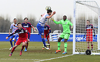 Reece Grego-Cox of QPR keeps the ball in play