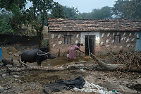 A woman cleans the courtyard of her hut in village Gorikothapally, Telangana, Indiia, on Friday, February 8, 2019. Photographer: Suzanne Lee for Safe Water Network