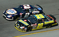 Ricky Rudd (28) and Rusty Wallace (2) race during the Daytona 500, Daytona International Speedway, Daytona Beach, FL, February 17, 2002.  (Photo by Brian Cleary/www.bcpix.com)