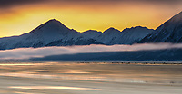 Winter landscape of the ice and water of Turnagain Arm flowing with the Kenai Mountains in the background at sunrise  in Southcentral, Alaska.  <br /> <br /> <br /> <br /> Photo by Jeff Schultz/SchultzPhoto.com  (C) 2017  ALL RIGHTS RESVERVED