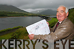 PLANNING: Caherciveen native James Clifford with plans he has designed for a ring road and other major developments in Caherciveen town..