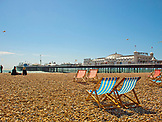 ENGLAND, Brighton,  the Pier and the Beach with Deckchairs