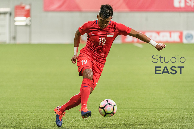 SINGAPORE, SINGAPORE - AUGUST 31: Khairul Amri of Singapore runs with the ball during the international friendly match between Singapore and Hong Kong at the Jalan Besar Stadium on August 31, 2017, in Singapore, Singapore. (Photo by Getty Images)