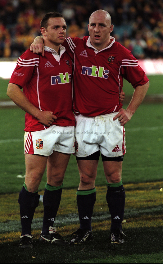 Photo. Richard Lane. .Australia v Bristish and Irish Lions. Lions Tour 2001 to Australia. Third Test at the Stadium Australia, Sydney, Australia. 14/7/2001..Rob Henderson (lt) is comforted by Keith Wood as the Lions lose the third test and Series..