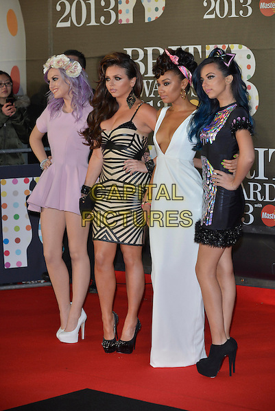 Little Mix (Perrie Edwards, Jesy Nelson, Leigh-Anne Pinnock and Jade Thirlwall).The Brit Awards 2013 arrivals at the O2, Greenwich, London, England 20th February 2013.The Brits full length band girl group pink white dress  purple hair flowers garland dyed hand on hip  black nude patterned low cut plunging neckline  bow shoes ankle boots side .CAP/PL.©Phil Loftus/Capital Pictures.