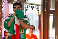 San Francisco, CA - Sunday, June 29, 2014: A Mexico fan enjoys having a lead against the Dutch at the SOMA StrEat Food Park watching the Netherlands vs. Mexico round of 16 World Cup match.