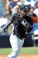 New York Yankees shortstop Eduardo Nunez #26 runs to first during a scrimmage against the USF Bulls at Steinbrenner Field on March 2, 2012 in Tampa, Florida.  New York defeated South Florida 11-0.  (Mike Janes/Four Seam Images)