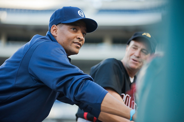 UNITED STATES - JULY 14:  Starting pitcher Rep. Cedric Richmond, D-La., left, and Rep. Earl Perlmutter, D-Colo., warm up before the 50th Annual Congressional Baseball Game at Nationals Park.  The Democrats prevailed over the Republicans by the score of 8-2.  (Photo By Tom Williams/Roll Call)