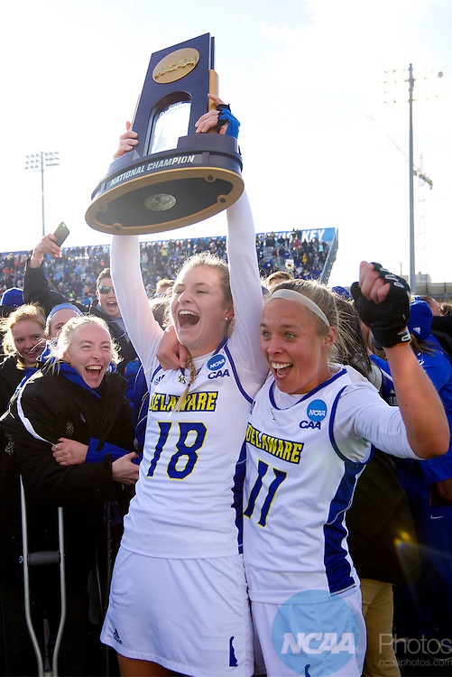 NORFOLK, VA - NOVEMBER 20:  Lisa Giezeman (11) and Maura Zarkoski (18) of the University of Delaware celebrate their victory over the University of North Carolina during the Division I Women's Field Hockey Championship held at the LR Hill Sports Complex on November 20, 2016 in Norfolk, Virginia.  Delaware defeated North Carolina 3-2 for the national title. (Photo by Jamie Schwaberow/NCAA Photos via Getty Images)