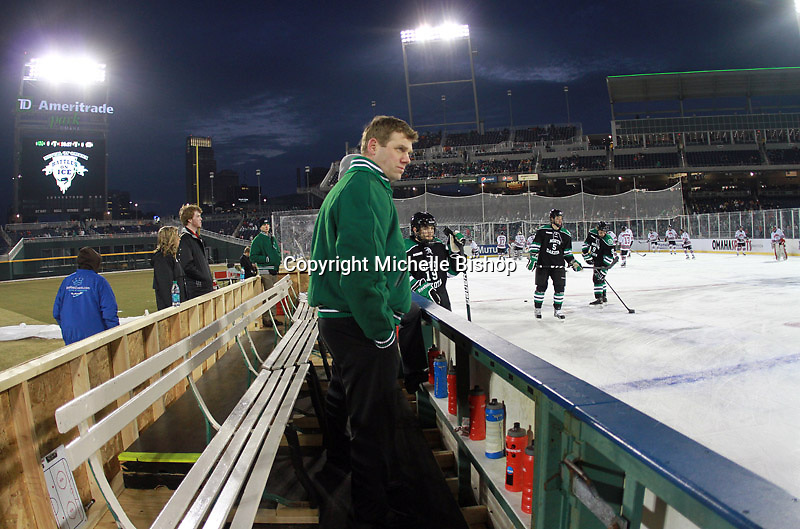 North Dakota players warm-up prior to the outdoor game against Nebraska-Omaha at TD Ameritrade Park in Omaha, Neb., Saturday, Feb. 9, 2013. (Photo by Michelle Bishop)