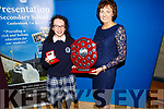 Aine Barry receives the Seamus Falvey Memorial trophy from Principal Katherina Broderick at the the Presentation Secondary School Castleisland's Students Awards evening on Monday.
