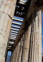 ATHENS, GREECE - APRIL 17 : A low angle view of the single row of outer columns of the Temple of Hephaestus, on April 17, 2007, in Athens, Greece. The Temple of Hephaestus was built on the Acropolis, between 449 and 415 BC, in the Doric Order. (Photo by Manuel Cohen)