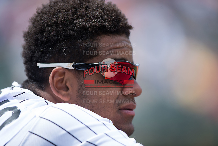 Louis Silverio (31) of the Charlotte Knights watches the action from the dugout during the game against the Indianapolis Indians at BB&T BallPark on June 19, 2016 in Charlotte, North Carolina.  The Indians defeated the Knights 6-3.  (Brian Westerholt/Four Seam Images)