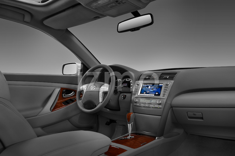 Passenger side dashboard view of a 2010 Toyota Camry Hybrid