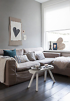 Different shades of grey have been used throughout the house, a colour that makes a perfect background for accent colours, such as the turquoise cushion in the living room