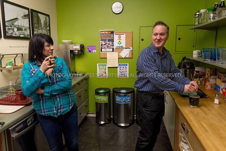 2/28/2014&mdash;Seattle, WA, USA<br /> <br /> Chris Hammersley, 42 (right), a Seattle based e-commerce executive, at Office Nomads, a coworking space in Seattle&rsquo;s Capitol Hill neighborhood. Here he meets a new 'nomad' in the communal kitchen, Aresou Arefi-Afshar, 32 (left), an attorney.<br /> <br /> Hammersley is based in Seattle, but his company HQ is in Walnut Creek, Ca. and his bosses live in Chicago and Boston. When meetings take place, they can happen anywhere, so Chris uses coworking spaces in those cities and others when he travels for work. <br /> <br /> <br /> Photograph by Stuart Isett. <br /> &copy;2013 Stuart Isett. All rights reserved.